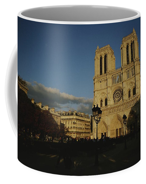 Europe Coffee Mug featuring the photograph An Exterior View Of Notre Dame by Raul Touzon