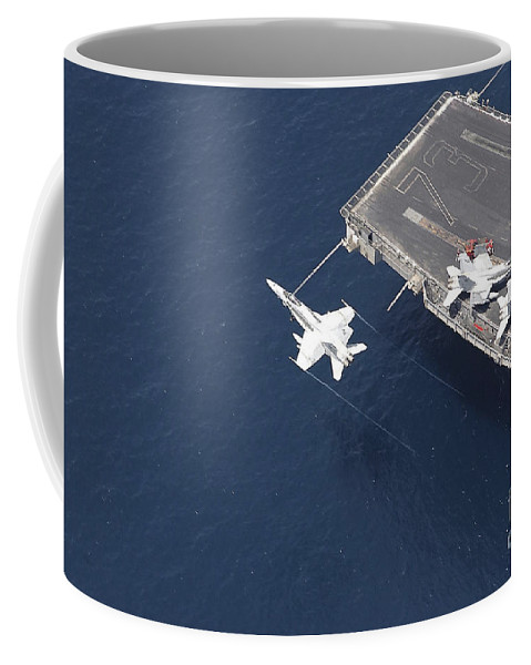 Horizontal Coffee Mug featuring the photograph An Fa-18 Hornet Flys Over Aircraft by Stocktrek Images
