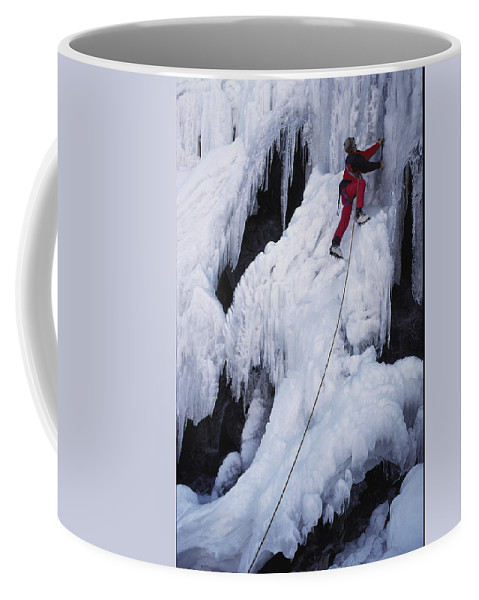 Model Released Photography Coffee Mug featuring the photograph An Ice Climber On Habeggers Falls by Gordon Wiltsie