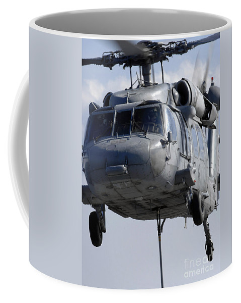 Adults Only Coffee Mug featuring the photograph An Mh-60s Seahawk Delivers A Pallet by Stocktrek Images