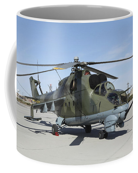 Horizontal Coffee Mug featuring the photograph An Mi-24 Hind Helicopter by Stocktrek Images