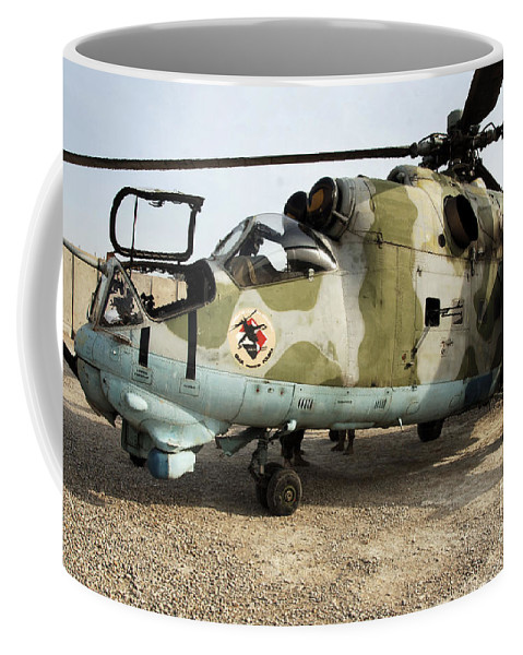 Polish Army Coffee Mug featuring the photograph An Mi-24 Russian Helicopter by Stocktrek Images