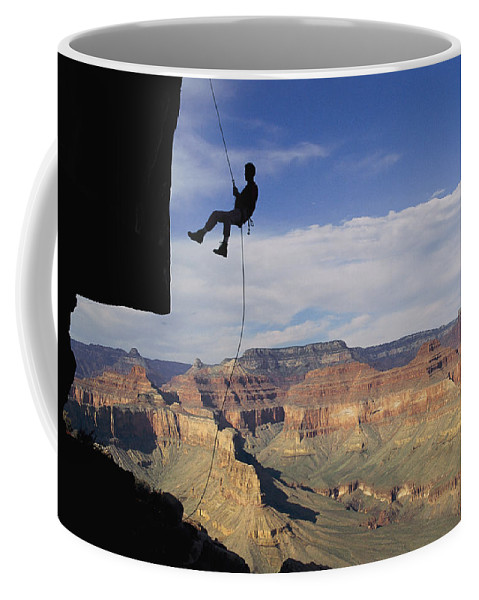 Grand Canyon National Park Coffee Mug featuring the photograph Andy Marquardt Rappels Down A Cliff by Bill Hatcher