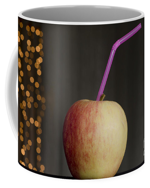 Apple Coffee Mug featuring the photograph Apple With Straw by Mats Silvan