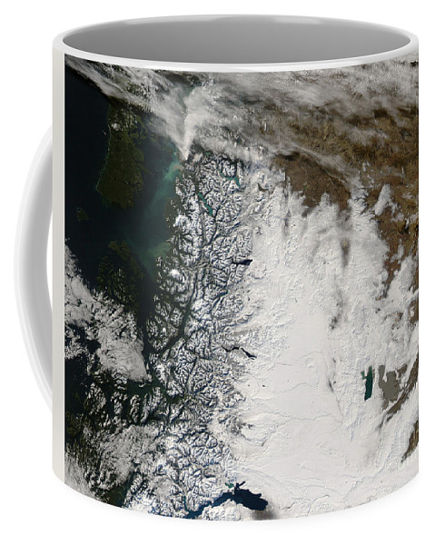 Argentina Coffee Mug featuring the photograph Ash Plume From Chaiten Volcano And Snow by Stocktrek Images