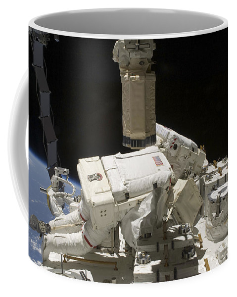 Sts-127 Coffee Mug featuring the photograph Astronauts Working On The International by Stocktrek Images