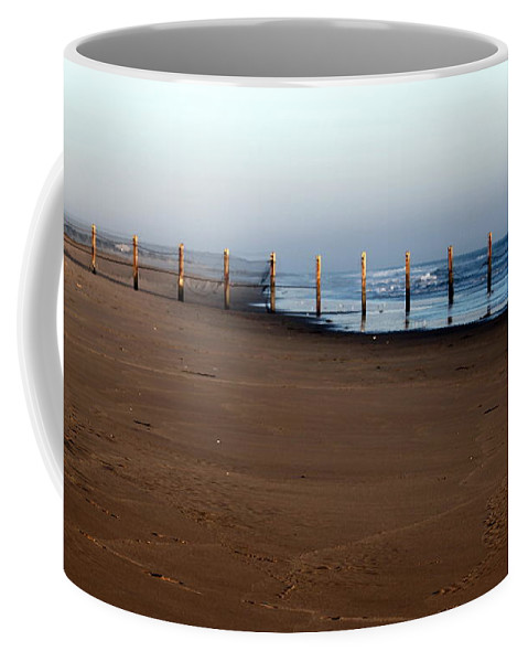 Fence Coffee Mug featuring the photograph Beach Fence by Henrik Lehnerer