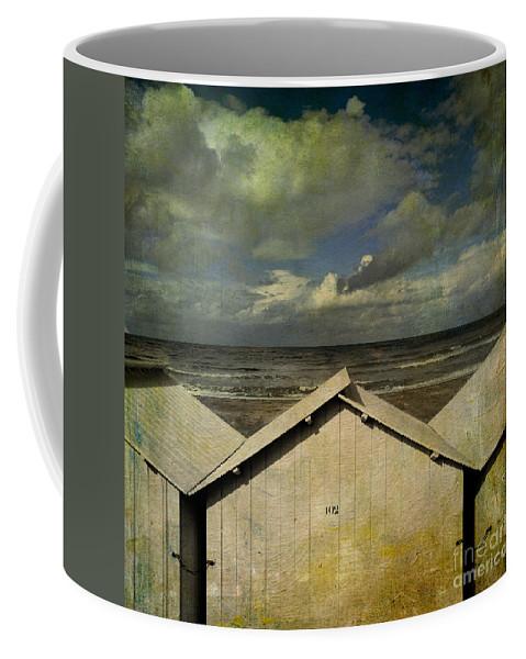 Yellowed Coffee Mug featuring the photograph Beach Huts Under A Stormy Sky. Vintage-look. Normandy. France by Bernard Jaubert