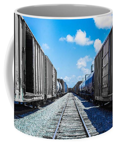 Tracks Coffee Mug featuring the photograph Between by Shannon Harrington
