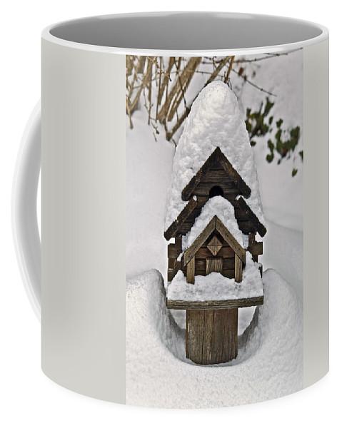Snow Coffee Mug featuring the photograph Birdhouse In Snow by Susan Leggett