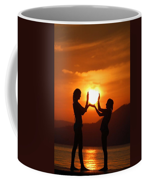 Silhouette Coffee Mug featuring the photograph Catching The Sun by Tara Ellis
