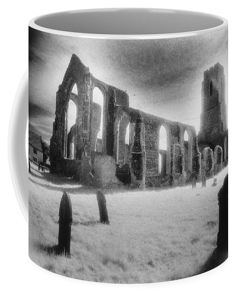 Bell Tower; Ruined; Ruin; Remains; Churchyard; Cemetery; Graveyard; Tombstones; Gravestones; Eerie; Atmospheric; Sinister; Ghostly; Dramatic; Striking; Mysterious; Gothic; Medieval; Architecture; English; Exterior; Landscape Coffee Mug featuring the photograph Church Of St Andrew by Simon Marsden