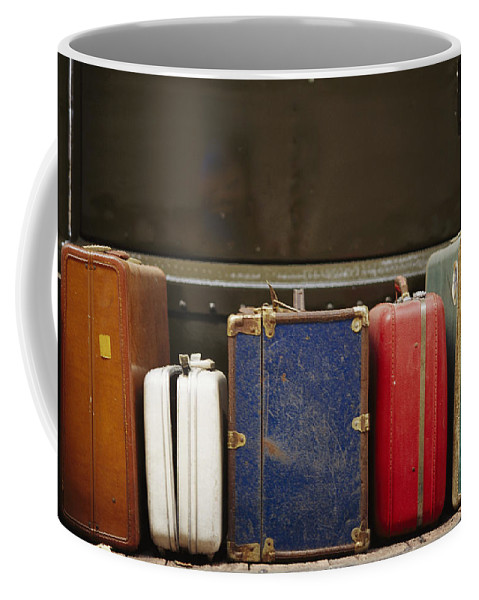 Subject Coffee Mug featuring the photograph Colorful But Worn Luggage Awaits by Raul Touzon