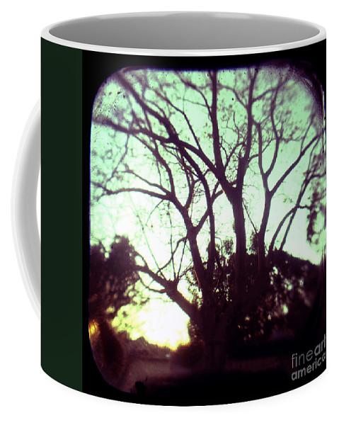 Aqua Coffee Mug featuring the photograph Crepescule by Andrew Paranavitana