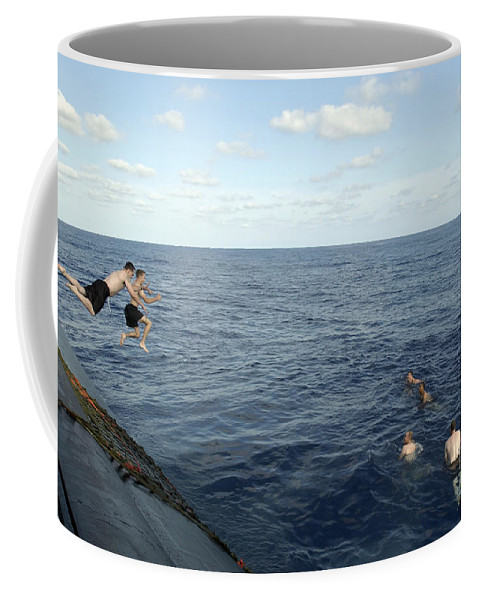 Uss Portsmouth Coffee Mug featuring the photograph Crew Members Of The Uss Portsmouth by Stocktrek Images