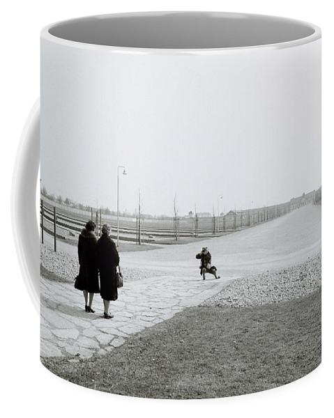 Holocaust Coffee Mug featuring the photograph Dachau Concentration Camp by Shaun Higson