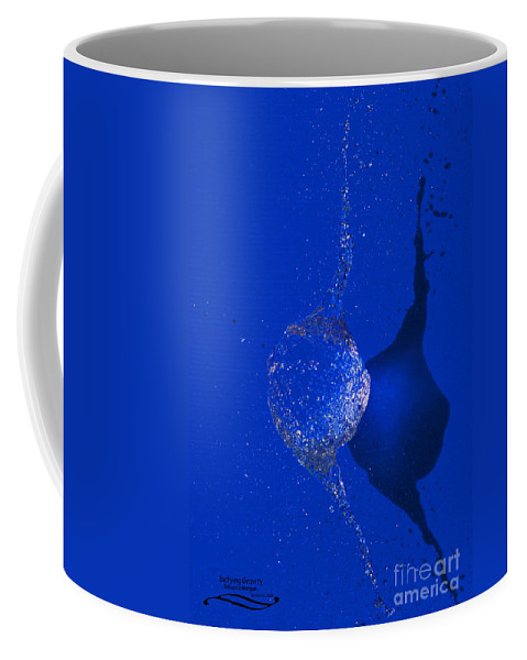 Water Coffee Mug featuring the photograph Defying Gravity by Rebecca Morgan