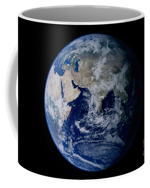 Color Image Coffee Mug featuring the photograph Earth From Space Showing Eastern by Stocktrek Images