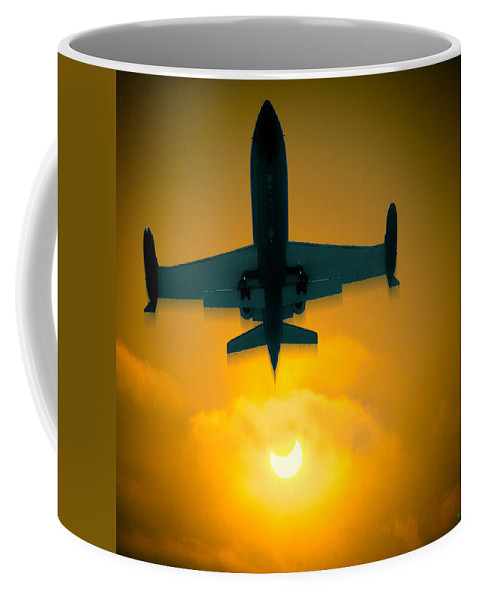 Jet Coffee Mug featuring the photograph Eclipse Of The Sun by Chris Lord