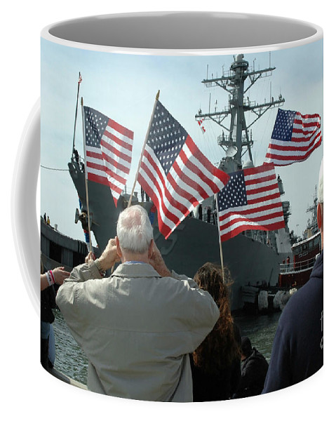 Color Image Coffee Mug featuring the photograph Family Members Wave Flags To Show by Stocktrek Images