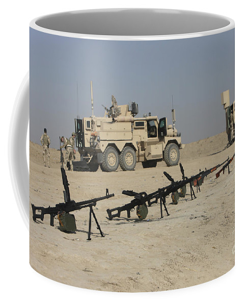 Machine Guns Coffee Mug featuring the photograph Firearms Sit Ready On A Firing Range by Terry Moore