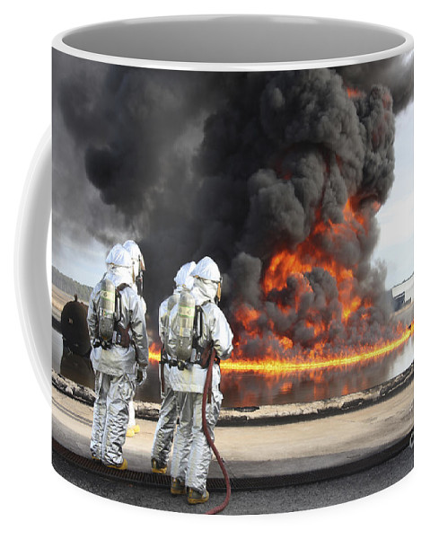 Military Coffee Mug featuring the photograph Firefighting Marines Watch by Stocktrek Images