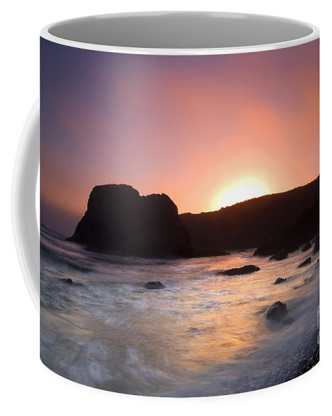 Yaquina Coffee Mug featuring the photograph From Light To Light by Mike Dawson