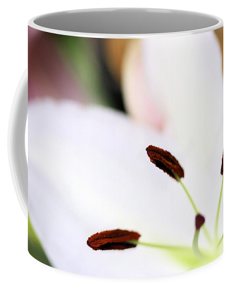 Lily Coffee Mug featuring the photograph From The Center by Angela Rath