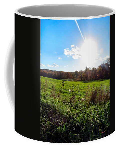 Field Coffee Mug featuring the photograph Giving Life by Art Dingo