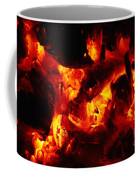 Glowing Coffee Mug featuring the photograph Glowing Ashes by Michal Boubin