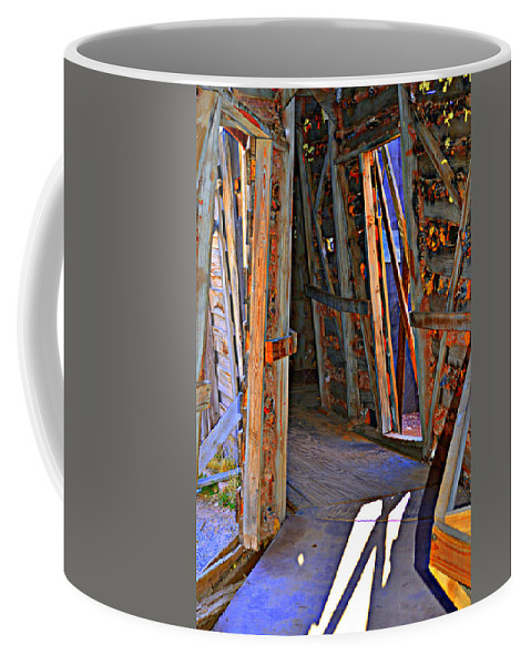 Tilts Coffee Mug featuring the photograph Gravity by Diane montana Jansson