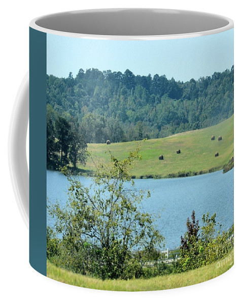 Hay Rolls On A Hill Coffee Mug featuring the photograph Hay Rolls On A Hill by Maria Urso