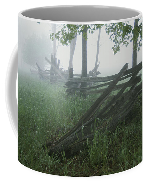 Natural Forces And Phenomena Coffee Mug featuring the photograph Heavy Fog Hangs Over Split Rail Fences by Stephen St. John