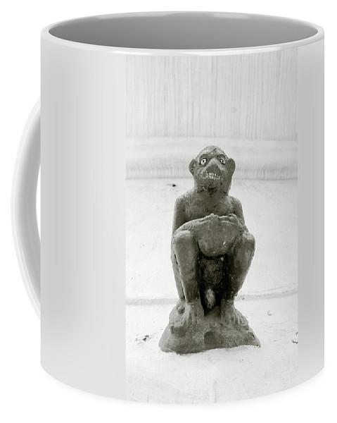 Surrealism Coffee Mug featuring the photograph The Demon by Shaun Higson
