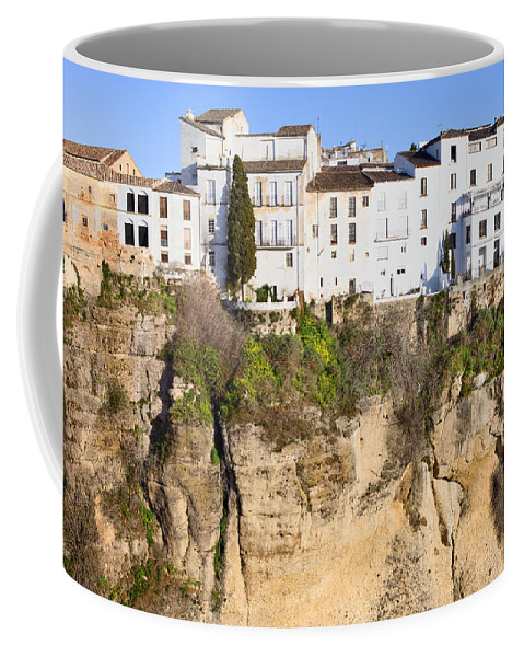 Ronda Coffee Mug featuring the photograph Houses On A Cliff In Ronda Town by Artur Bogacki