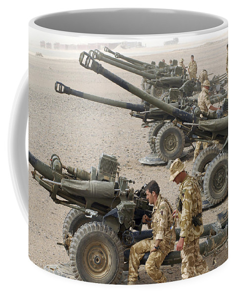Armament Coffee Mug featuring the photograph Howitzer 105mm Light Guns Are Lined by Andrew Chittock