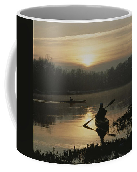 Scenes And Views Coffee Mug featuring the photograph Kayakers Paddle Through Still Water by Sam Kittner