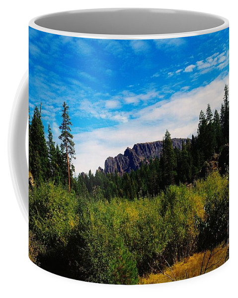 Mountains Coffee Mug featuring the photograph Klutchman Rock by Jeff Swan