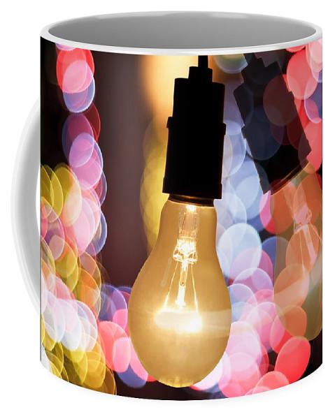 Blur Coffee Mug featuring the photograph Light Bulb And Bokeh by Setsiri Silapasuwanchai