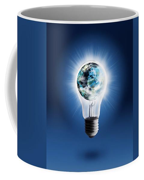 Art Coffee Mug featuring the photograph Light Bulb With Globe by Setsiri Silapasuwanchai