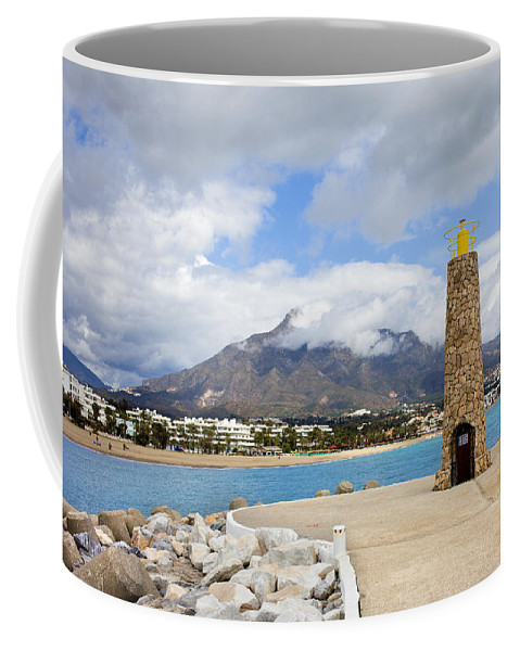 Sea Coffee Mug featuring the photograph Lighthouse On Costa Del Sol In Spain by Artur Bogacki