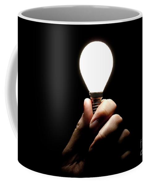 Light Bulb Coffee Mug featuring the photograph Lit Lightbulb Held In Hand by Simon Bratt Photography LRPS