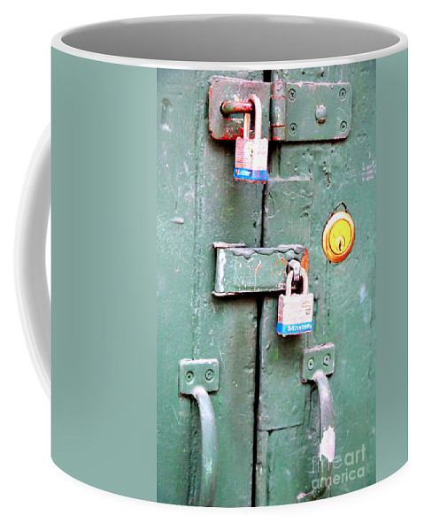 New Orleans Coffee Mug featuring the photograph Locked Tight by Carol Groenen