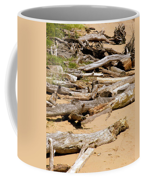 Driftwood Coffee Mug featuring the photograph Lonely Driftwood by Trish Tritz