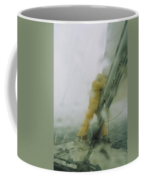 Seamen Coffee Mug featuring the photograph Man Reefing Mainsail In Heavy Weather by Skip Brown
