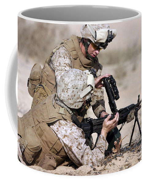 Military Coffee Mug featuring the photograph Marine Gives Instructions On How by Stocktrek Images
