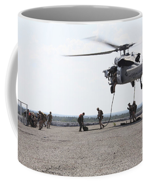Military Training Coffee Mug featuring the photograph Marines Fast-rope Onto Their Objective by Stocktrek Images