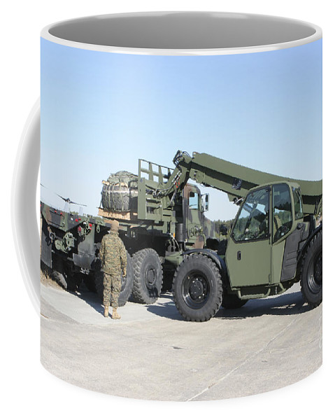 Horizontal Coffee Mug featuring the photograph Marines Pick Up Palletized Logistics by Stocktrek Images