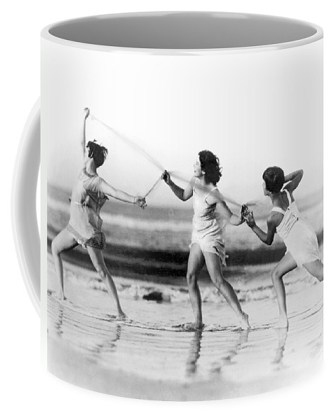 18-19 Years Coffee Mug featuring the photograph Modern Dance On The Beach by Underwood Archives