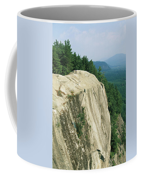 North America Coffee Mug featuring the photograph Mountain Biker On Edge Of Cliff by Skip Brown